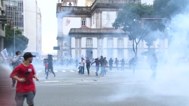 crowds flee from police tear gas grenades. a general strike in opposition to president michel temer's proposed legislative reform resulted in... - tear gas stock videos & royalty-free footage