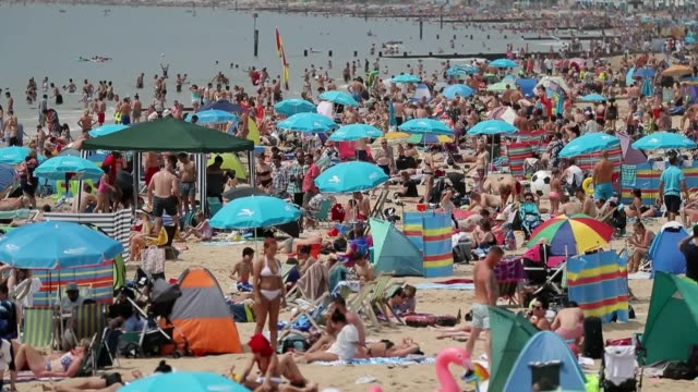 crowds flock to bournemouth beach dorset as the hot weather continues across the country uk temperatures reached a high of 295c on june 30 - bournemouth england stock videos & royalty-free footage