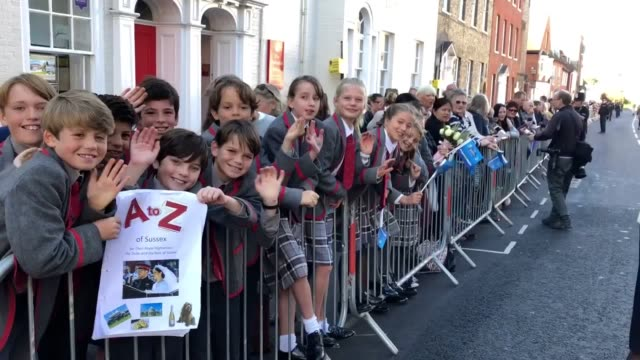 Crowds full of local school children wait for the Duke and Duchess of Sussex to arrive at Edes House West Street Chichester as part of their first...