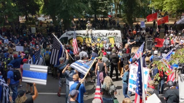 crowds gather as right wing groups and portland anti-police protesters face off in front of the multnomah county justice center on august 22, 2020 in... - portland oregon stock videos & royalty-free footage