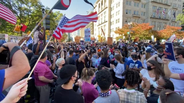 crowds gather at blm plaza near the white house to celebrate news that the former vice president, democratic candidate joe biden will be the 46th... - celebration stock videos & royalty-free footage