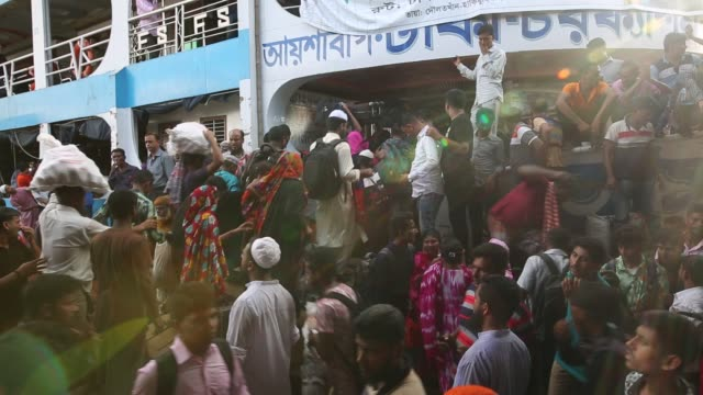 crowds gather at sadarghat launch terminal in dhaka bangladesh to reach their hometowns ahead of the muslim holiday of eid aladha - dhaka stock videos & royalty-free footage