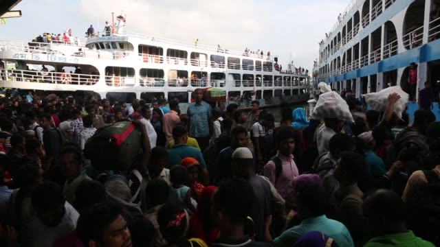 crowds gather at sadarghat launch terminal in dhakabangladesh to reach their hometowns ahead of the muslim holiday of eid aladha - dhaka stock videos & royalty-free footage