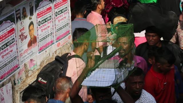 crowds gather at sadarghat launch terminal to reach their hometowns ahead of eid aladha in dhaka bangladesh - dhaka stock videos & royalty-free footage