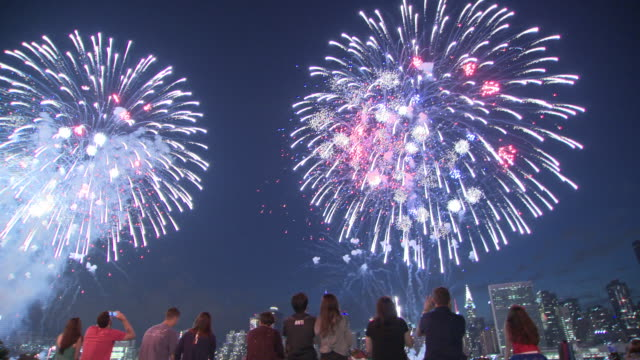 Crowds gather in Manhattan and Queens to view the annual Macy's 4th of July fireworks