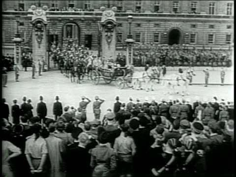Crowds gather on the sidewalks before the beginnging of London's Victory Parade celebrating their World War II victory / Soldiers marching down the...