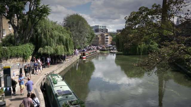crowds gather on the towpath for the the islington canal festival - islington stock videos & royalty-free footage