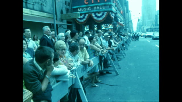 crowds gather outside radio city music hall in new york city to watch video of the apollo 11 moon landing - radio city music hall stock videos & royalty-free footage