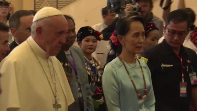 Crowds gather outside Saint Mary's cathedral in Yangon as Pope Francis holds a mass for young people on the final day of his trip to Myanmar