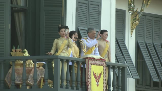 crowds gather to see maha vajiralongkorn bodindradebayavarangkun the new king of thailand make and appearance with the queen from left her royal... - king of thailand stock videos and b-roll footage