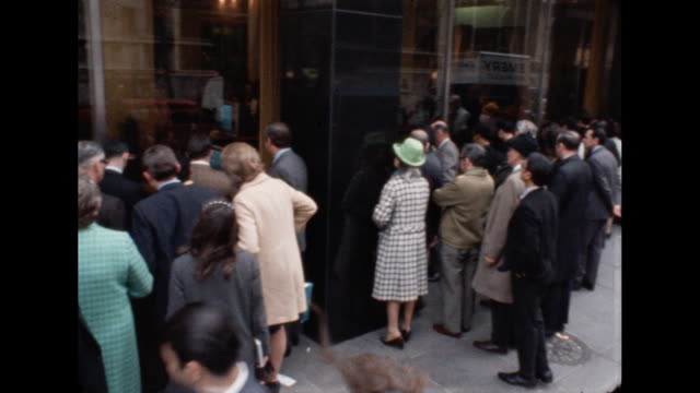crowds gather to watch a television in a store window to see the successful landing of apollo 13. - splashdown stock videos & royalty-free footage