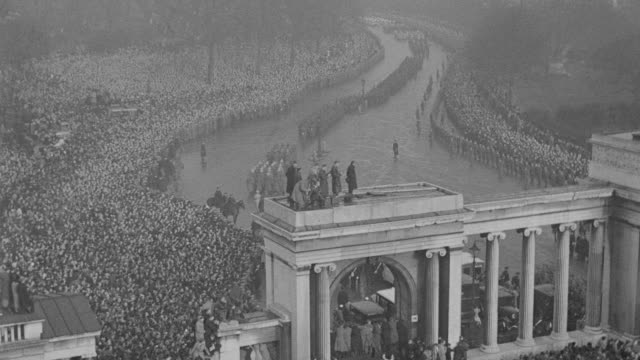 crowds gather to watch the rainy funeral procession of king george v in london. - mourning stock videos & royalty-free footage