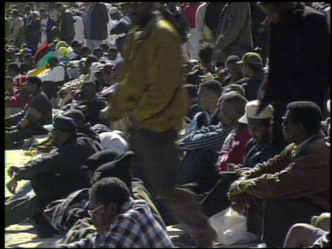 / crowds gathered at the million man march / interviews with attendees million man march on october 16 1995 in washington dc - 1995 stock-videos und b-roll-filmmaterial