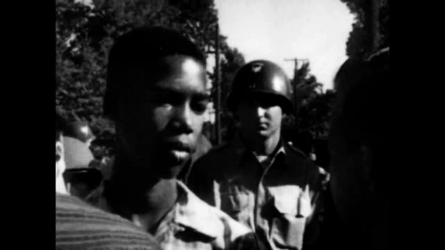 crowds gathered to watch 'little rock nine' be escorted to school / crowds start to push and shove each other - separation stock videos & royalty-free footage