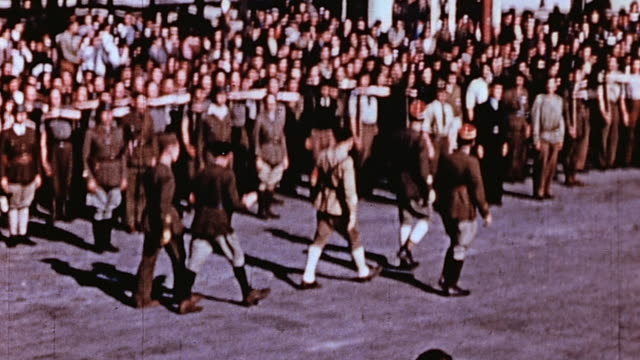 crowds gathering at parade after liberation / france - esercito militare francese video stock e b–roll