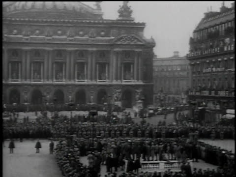 Crowds gathering in square / Paris France
