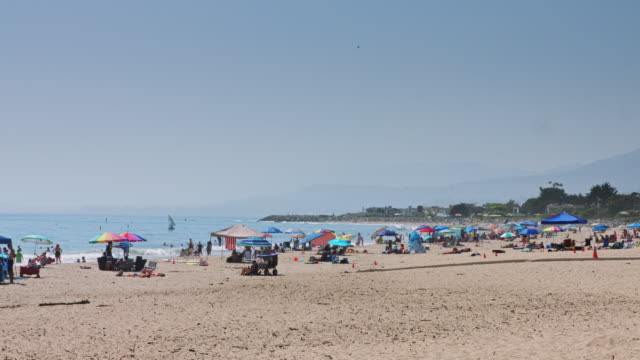 Crowds Having Fun at the Beach