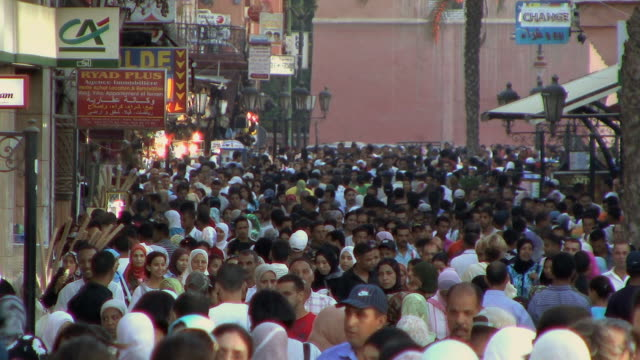 WS HA Crowds heading to Djemaa el Fna square at dusk, Marrakech, Morocco