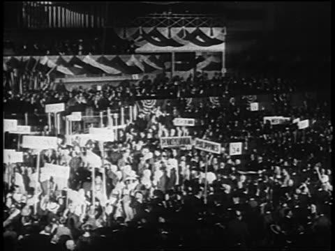 vídeos de stock e filmes b-roll de b/w 1920 crowds holding signs at democratic national convention / san francisco - eleição presidencial dos estados unidos da américa