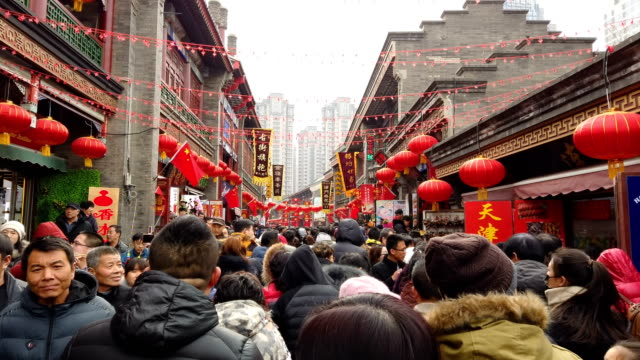 crowds in ancient cultural street during chinese spring festival/ tianjin, china - tianjin stock videos & royalty-free footage