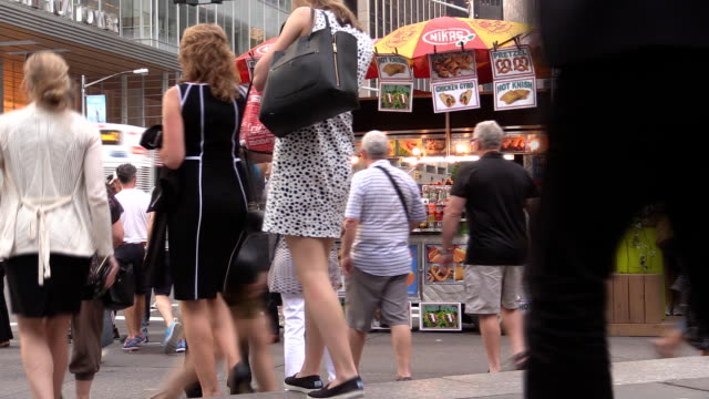 crowds in front of hot dog stand in midtown manhattan - concession stand stock videos and b-roll footage
