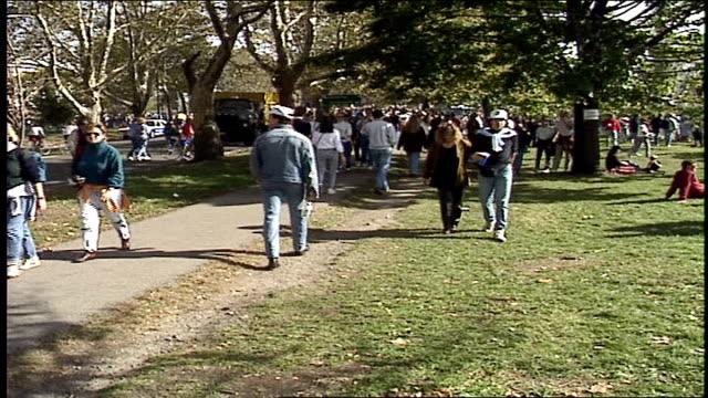 crowds in harvard sq for head of the charles regatta in boston - 1990年点の映像素材/bロール
