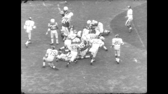 crowds in packed stadium watch as colts play the giants / players mentioned: gino marchetti, johnny unitas, john mackey, ya tittle, phil king, joe... - nfc east stock videos & royalty-free footage