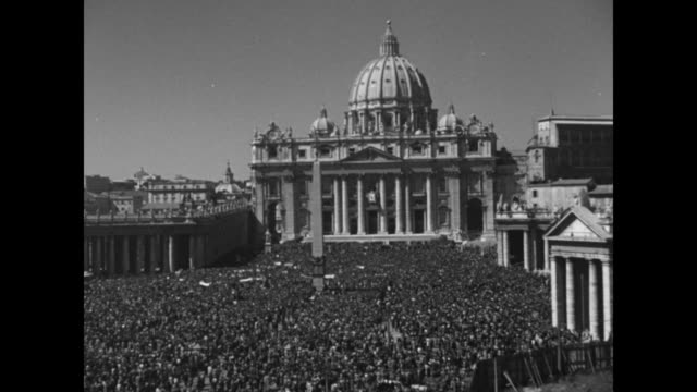 vws crowds in st peter's square with basilica in bg / nice shot of basilica dome pan down to crowd / vs crowds in st peter's square with basilica in... - priest stock videos and b-roll footage