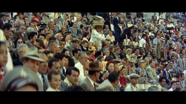 ms crowds in stands at bullfight / mexico - bullfighter stock videos & royalty-free footage