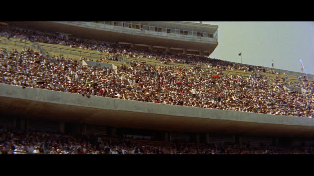 ws crowds in stands of university of mexico stadium / mexico - anno 1957 video stock e b–roll