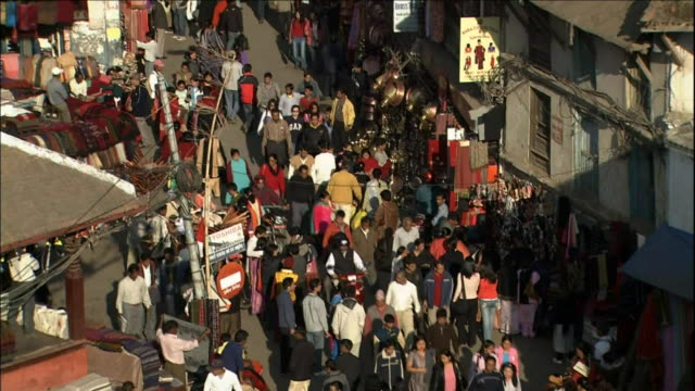 Crowds in street of downtown Kathmandu_Medium Shot_Tilt Up
