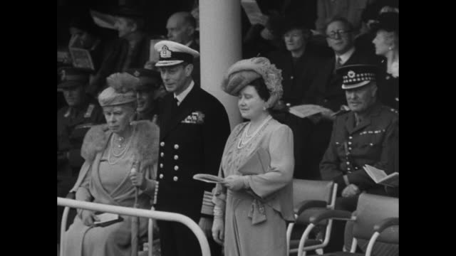 crowds in trafalgar square during london's world war ii victory parade; nelson's column stands in background / montage tanks, military vehicles move... - prime minister stock videos & royalty-free footage