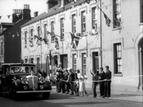 crowds line a street in lisburn as the queen and prince philip drive through the town during their state visit to northern ireland 1953 - 1953 stock videos & royalty-free footage
