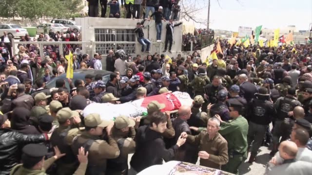 Crowds line the streets of the southern city of Hebron to pay their respects as the cortege carrying the body of 63 year old prisoner Maisara Abu...