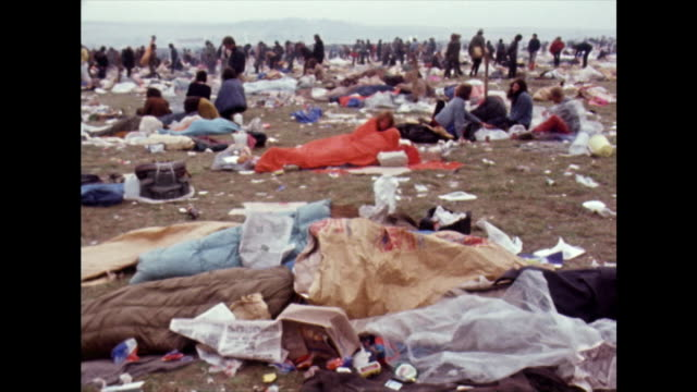 crowds lingering after isle of wight festival ends; 1970 - arts culture and entertainment stock videos & royalty-free footage