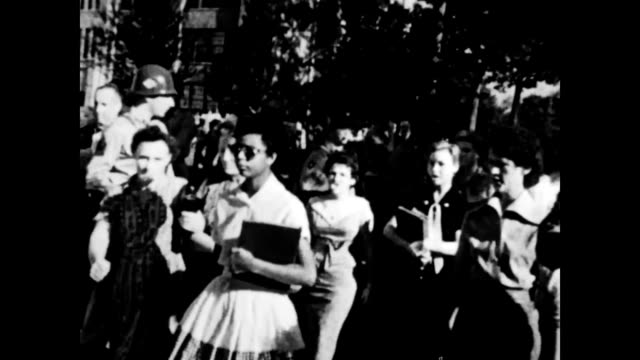 crowds lining streets watching students arrive at school angry while people - jim crow laws stock videos & royalty-free footage