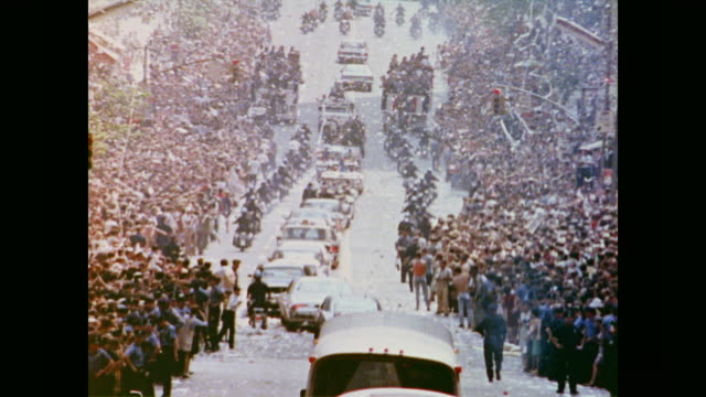 crowds look down the lined streets of the ticker tape homecoming parade for the apollo 11 mission - parade stock videos & royalty-free footage