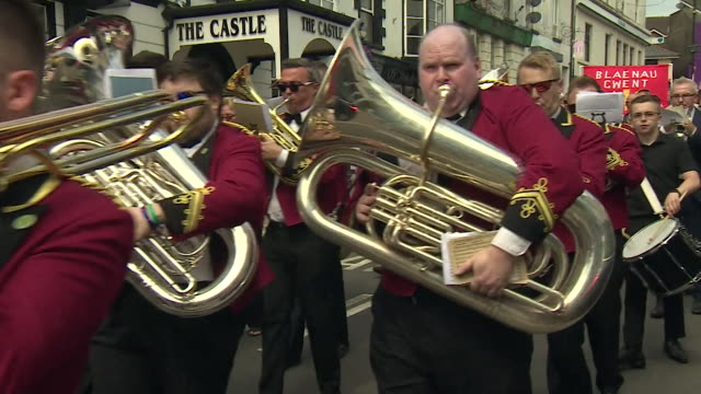 crowds marching in tredegar wales in rememberance of aneurin bevan founder of the nhs - brass band stock videos & royalty-free footage