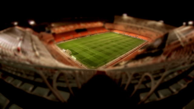 vidéos et rushes de crowds move in and out of valencia cf soccer stadium before and after a game. - spain