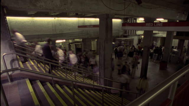 crowds moving on staircase, through terminal - formato video mpeg video stock e b–roll