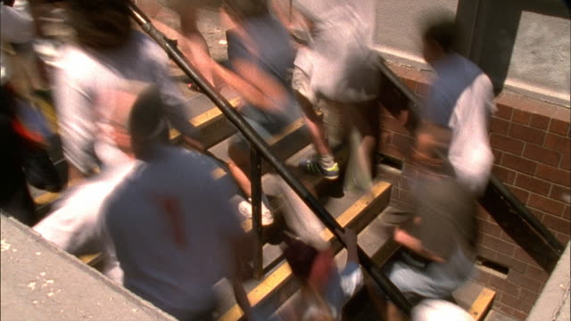 crowds moving up staircase - mpeg videoformat stock-videos und b-roll-filmmaterial