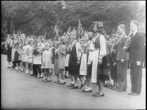 Crowds near Albert Memorial in London England / King Haakon VII of Norway Crown Princess Martha and Crown Prince Olaf exiting car and greeting...