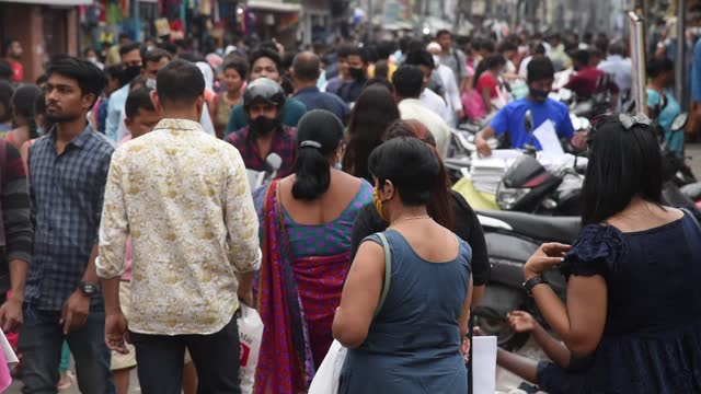crowds, not adhering to social distancing norms, throng at fancy bazar, during ramadan month, amid covid-19 coronavirus pandemic, on april 13 in... - indian ethnicity stock videos & royalty-free footage