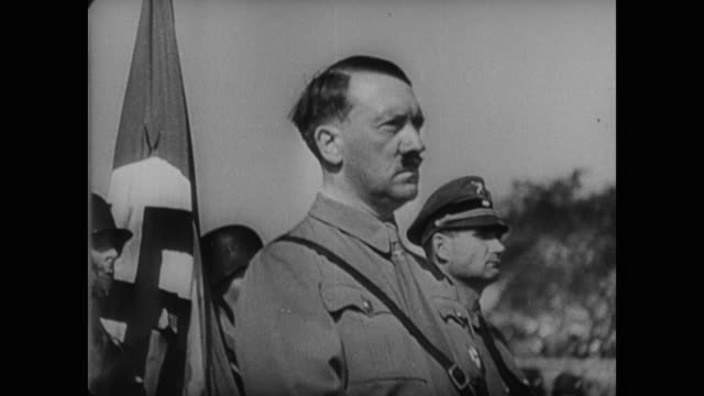 stockvideo's en b-roll-footage met crowds of adoring followers salute a stern adolf hitler as he looks down on the members of the nazi party during the annual nuremberg rally - nazism