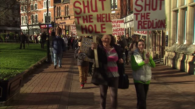 crowds of anti abattoir protesters marching through centre of nantwich, cheshire with placards nantwich abattoir protest on february 02, 2013 in... - ナントウィッチ点の映像素材/bロール