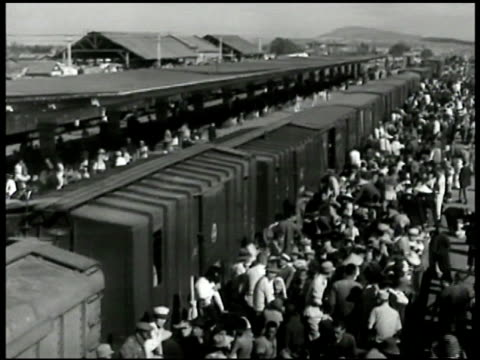 crowds of chinese refugees boarding train train station. refugees overloaded on slow moving train. red china russia soviet union communism - communism stock videos & royalty-free footage