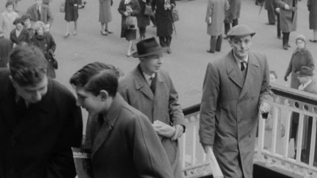 montage crowds of commuters exiting a train and walking through a station and railway workers conversing / united kingdom - british rail stock videos & royalty-free footage