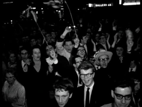 Crowds of England fans cheer and wave flags after England won 1966 Football World Cup outside the Royal Garden Hotel London 31 Jul 66