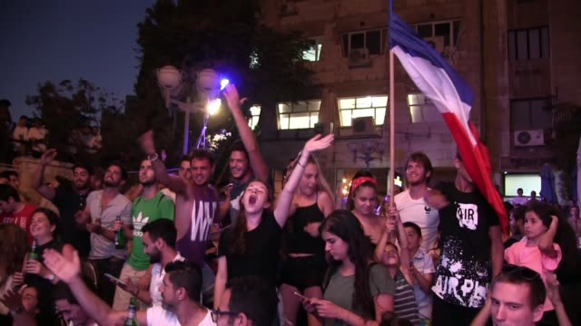 crowds of excited french jews and fans gather in downtown jerusalem to celebrate france winning the world cup 2018 final against croatia - french flag stock videos & royalty-free footage
