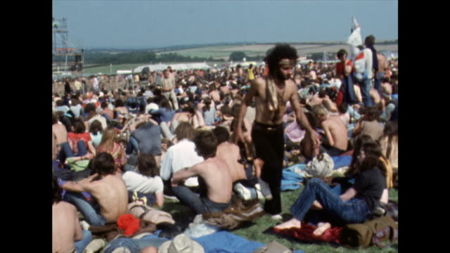 crowds of festival goers relaxing in the sun; 1970 - coastal feature stock videos & royalty-free footage
